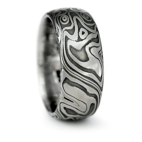 damascus steel domed wedding band with four pointed swirling star pattern with dark fire patina bold masculine handmade wedding ring - Damascus Wedding Ring