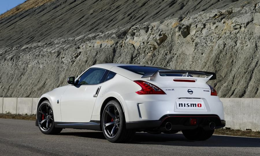 Outside Red Pinstriping And Dark Gray Accents Have Been Added To The Front And Rear Fascias Lower Side Sills Side Nissan Nismo Nissan 370z Nismo Nissan 370z
