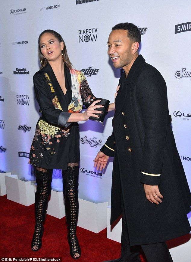 Doorman: Her husband John Legend, meanwhile, looked dapper in a black doorman-style coat...