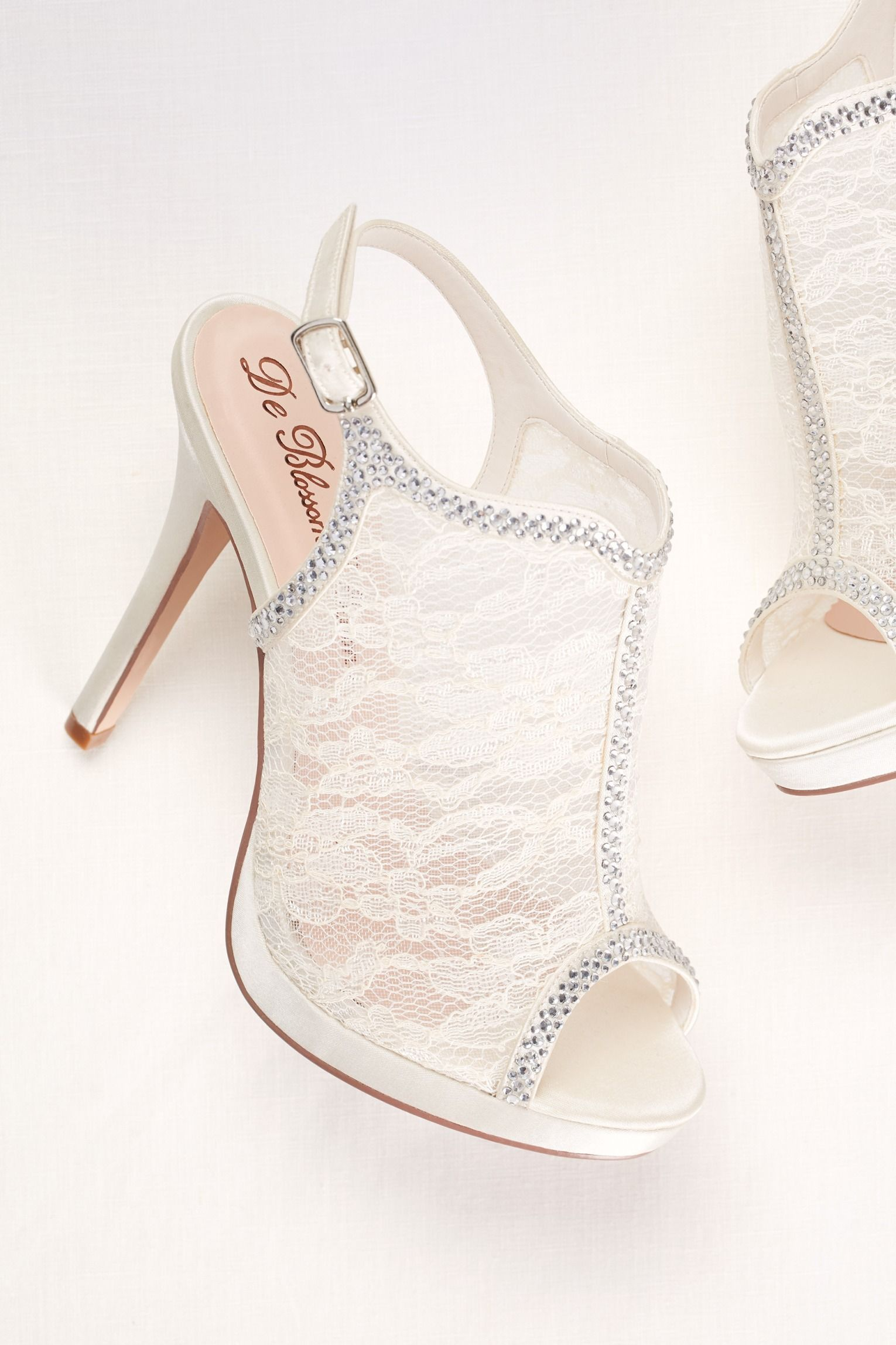 31f8cb6307b The perfect wedding shoe. Floral inspired lace and modern crystals ...