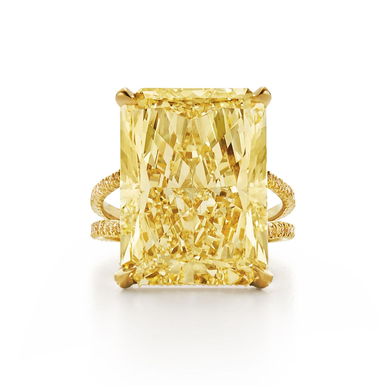 Radiant fancy yellow diamond ring with split yellow