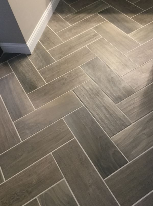 Emblem Gray 7x20 Tiles On Floor In Herringbone Pattern Herringbone Tile Floors Patterned Floor Tiles Entryway Flooring