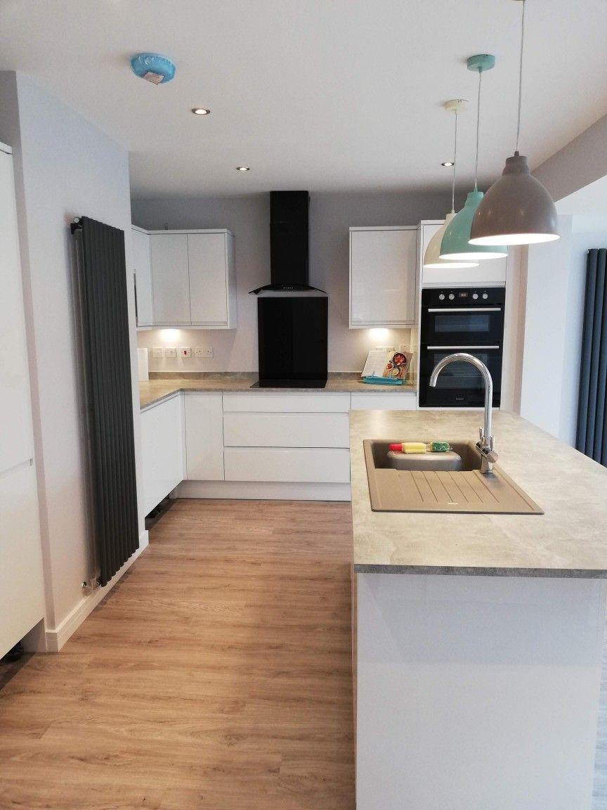 Howdens Clerkenwell White Gloss Kitchen White Gloss Kitchen Minimal Kitchen Design Open Plan Kitchen Dining Living