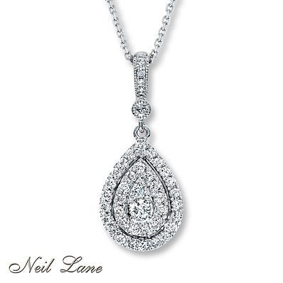 Contemporary in style while reminiscent of vintage glamour, designs by Neil Lane are truly timeless. Here, brilliant round diamonds decorate a teardrop of 14K white gold. Additional diamonds sparkle above. The diamond pendant, from the Neil Lane Designs® collection, has a total diamond weight of 1/2 carat and is crafted in 14K white gold. The cable chain is adjustable from 17 to 19 inches in length and is secured with a lobster clasp. Diamond Total Carat Weight may range from .45 - .57…