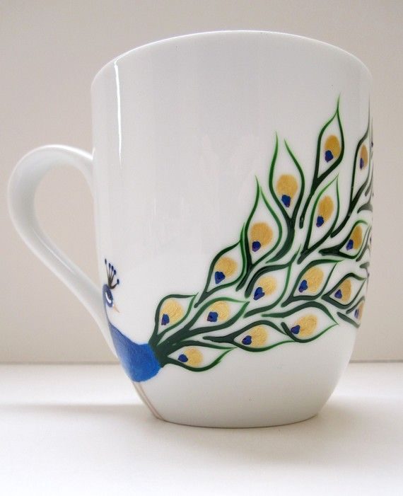 hand painted peacock on a ceramic coffee mug lovely