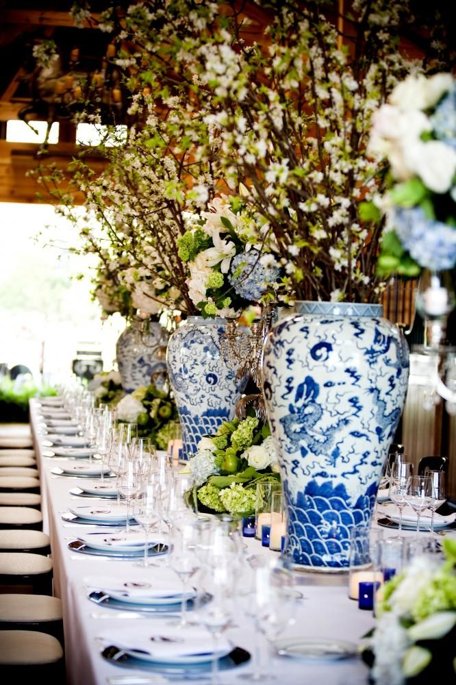 too big for dining table but huge blue and white vases plus mossy green hydrangeas or moss balls nice for serving tables