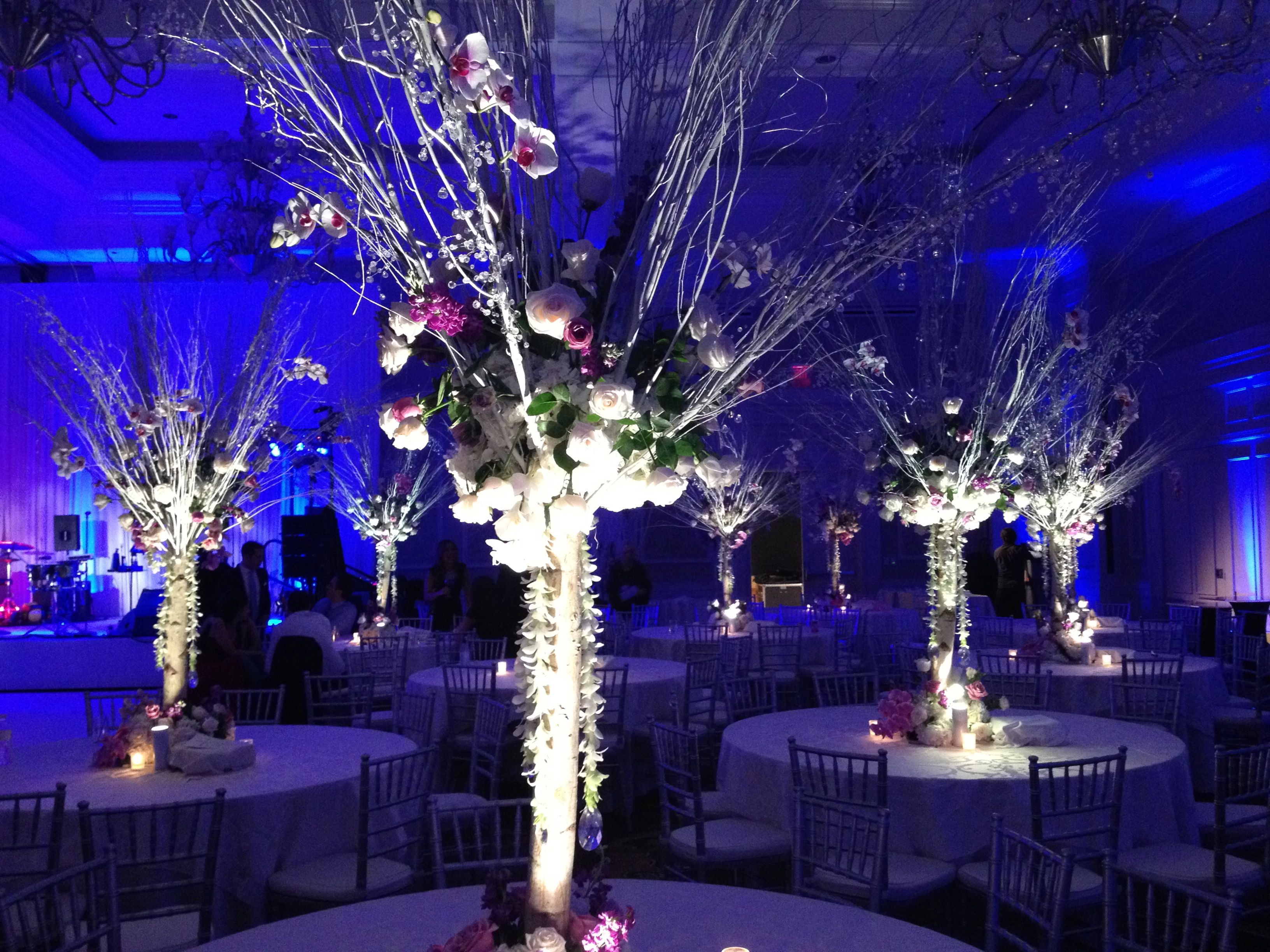 White Birch Tree Trunk Centerpieces With White Orchid And Crystal Garlands Www Rainingroses Biz White Birch Trees Crystal Garland Tree Centerpieces