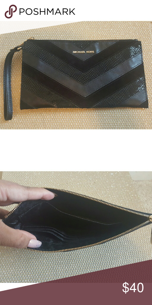 a941062aa87b Michael Kors Wristlet Never used. Herringbone pattern of black leather