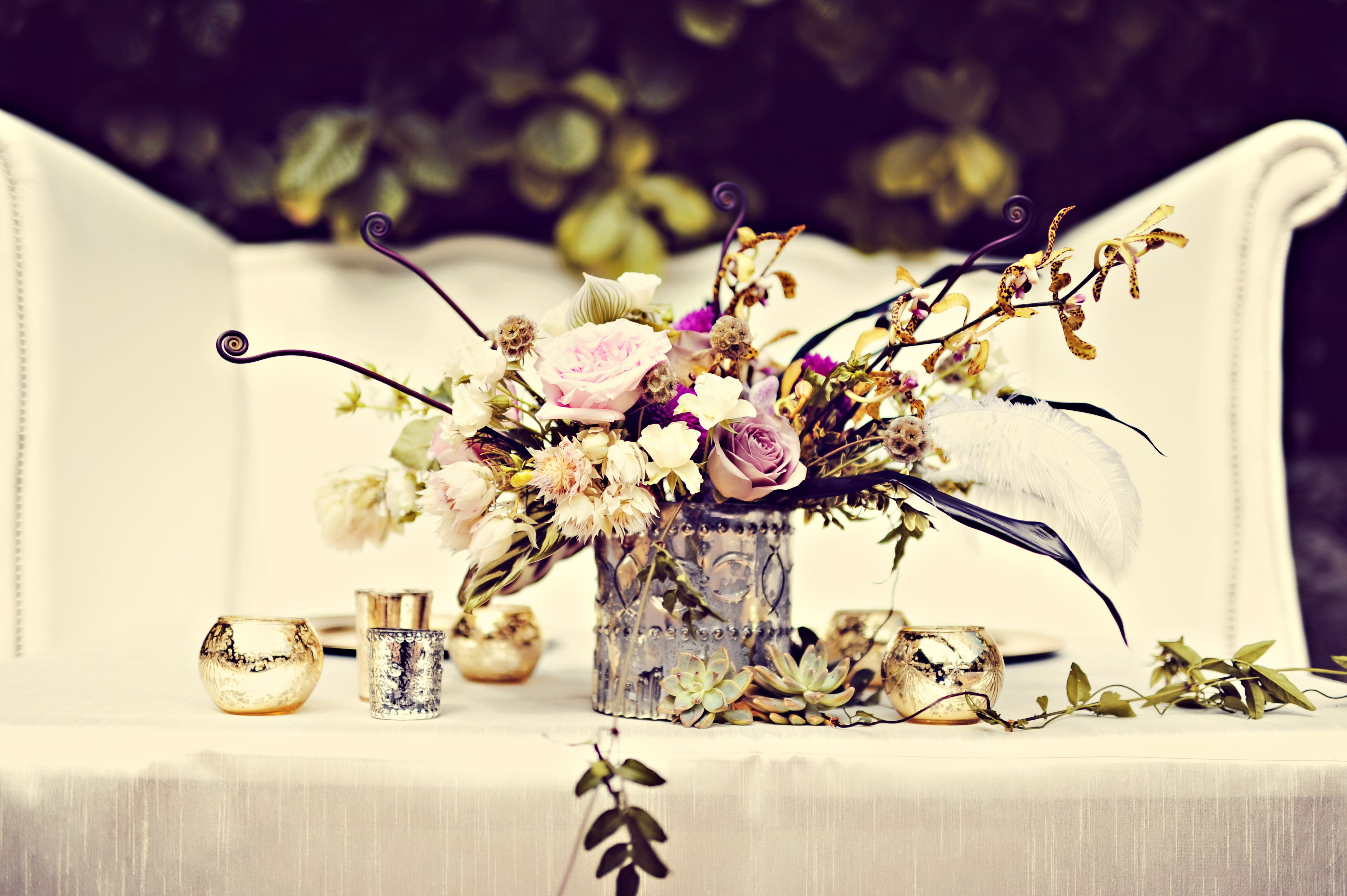 Stunning flowers and art decor at this reception