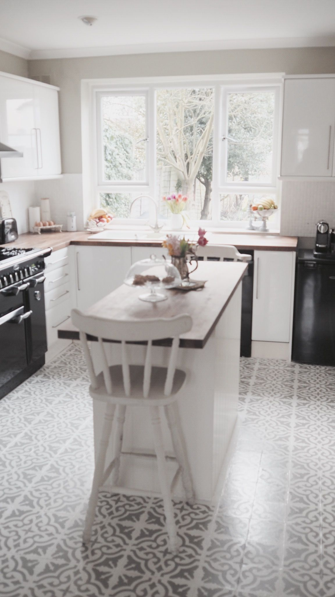 The kitchen needed some light injected into it. With a stencilled floor and white cabinets, the only pops of true colour are the flowers and fruit. Perfect. Walls are in Farrow & Ball French Gray. Getting the colours right for French opulence.