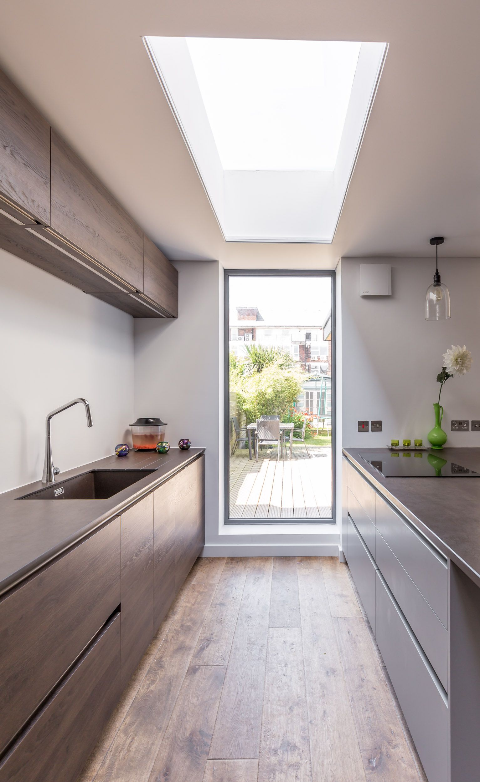Modern kitchen extension | sleek design | framed garden views | floor to ceiling window | flat rooflight