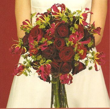 Gloriosa S Are Great For Wedding Bouquets They Add A Fresh Natural Look To Your Arrang Christmas Wedding Flowers Wedding Flower Photos Wedding Flower Pictures