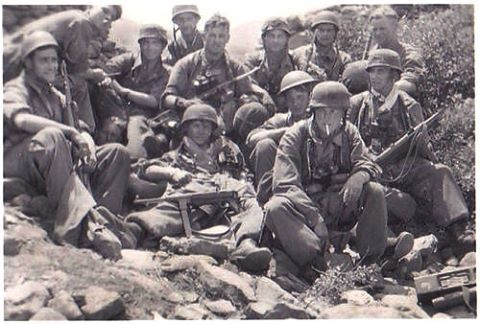 German paratroopers of the II Sturm Regiment pausing for a rest and a photo after days of hard fighting during the invasion of Crete. The terrible losses suffered in the campaign convinced Adolf Hitler to never again attempt a large scale airborne attack.