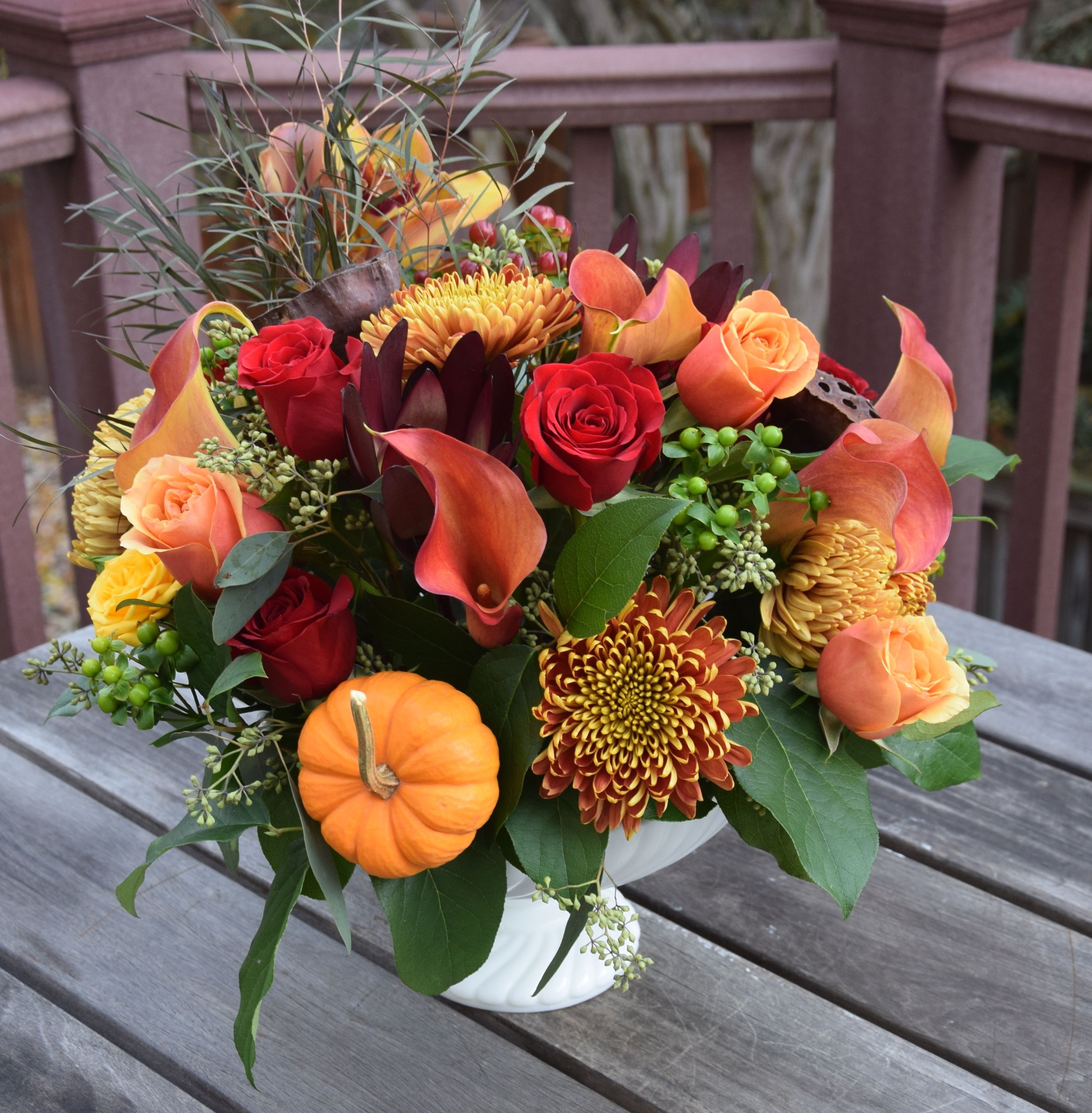 Thanksgiving table centerpiece with fresh pumpkins