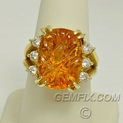 Immense Citrine and Diamond Ring in 14KT Yellow Gold -Outstanding orange-yellow citrine carved by Andrew Gulij. It measures 17.6 x 12.8 mm., and weighs13.87 carats. Framed by 6 sparkling diamonds, .65 carats total weight. Heavy 14KT yellow gold setting has double prongs and a high-polish finish. Ring is handmade, one of a kind and is a size 8 1/2. Price: $2,950 Gemfix