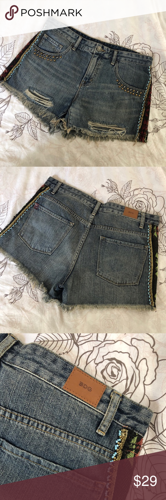 Urban Outfitters cutoff denim shorts - size 30 UO denim cutoff shorts with studs and beaded and embroidery detail. Barely worn, perfect condition. Size 30 Urban Outfitters Shorts Jean Shorts #denimcutoffshorts