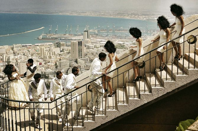 Israel—Positioning themselves for a photo shoot in Haifa, two Eritrean expats and their wedding party are a vision in white. Israel is home to 34,000 asylum-seekers from Eritrea. Only four have been granted refugee status under a controversial immigration law.