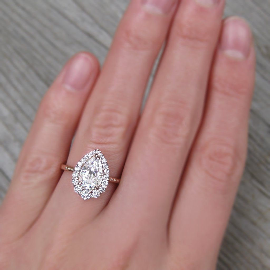 Rose gold Forever One pear moissanite halo engagement ring with ...