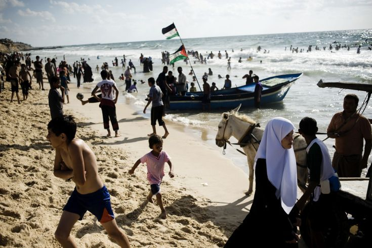 Palestinians enjoy the Mediterranean Sea at a Hamas-run beach-side day resort in Gaza City, Palestinian Territories, July 28, 2010.  http://lightbox.time.com/2012/06/14/andrea-bruce-receives-the-chris-hondros-fund-award/#ixzz2QwS9MIqF