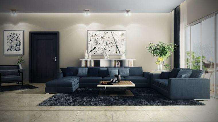 Salotti moderni con un divano blu e tavolino di legno quadrato