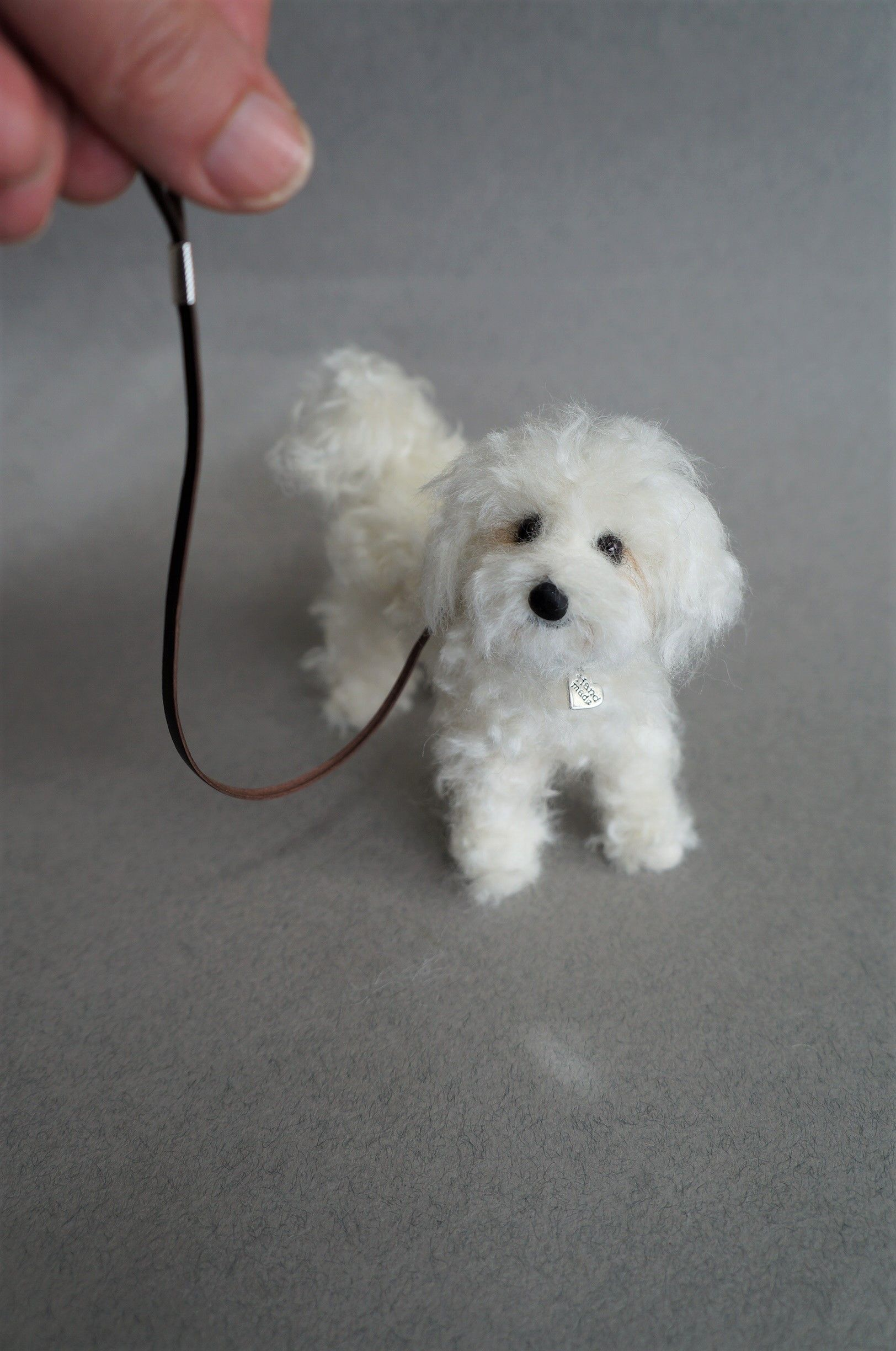 A needle felted Maltese. About 4 inches long