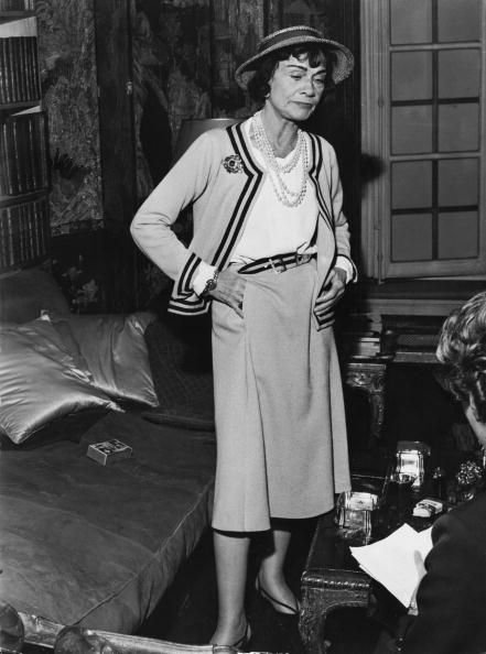 3febc6d1505 French fashion designer Coco Chanel in her apartment at the Hotel...