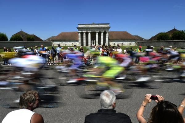 Scenic shots of the 2014 Tour de France | The pack rides during the 187.5 km eleventh stage of the 101st edition of the Tour de France cycling race on July 16, 2014 between Besancon and Oyonnax, eastern France.