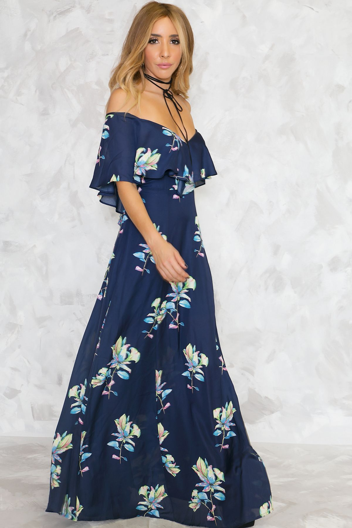 4875f442464ef The Talk To Me Floral Maxi Dress features a navy multi-colored floral  print