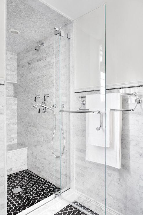 The White Marble Walls Contrast Beautifully With The Black Hex Flooring What Do You Think Of It From Shower Tile Penny Tiles Bathroom White Marble Bathrooms