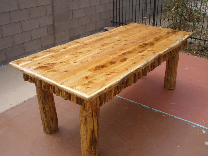 7 foot dining table, cedar top, pine logs, sold for: $600