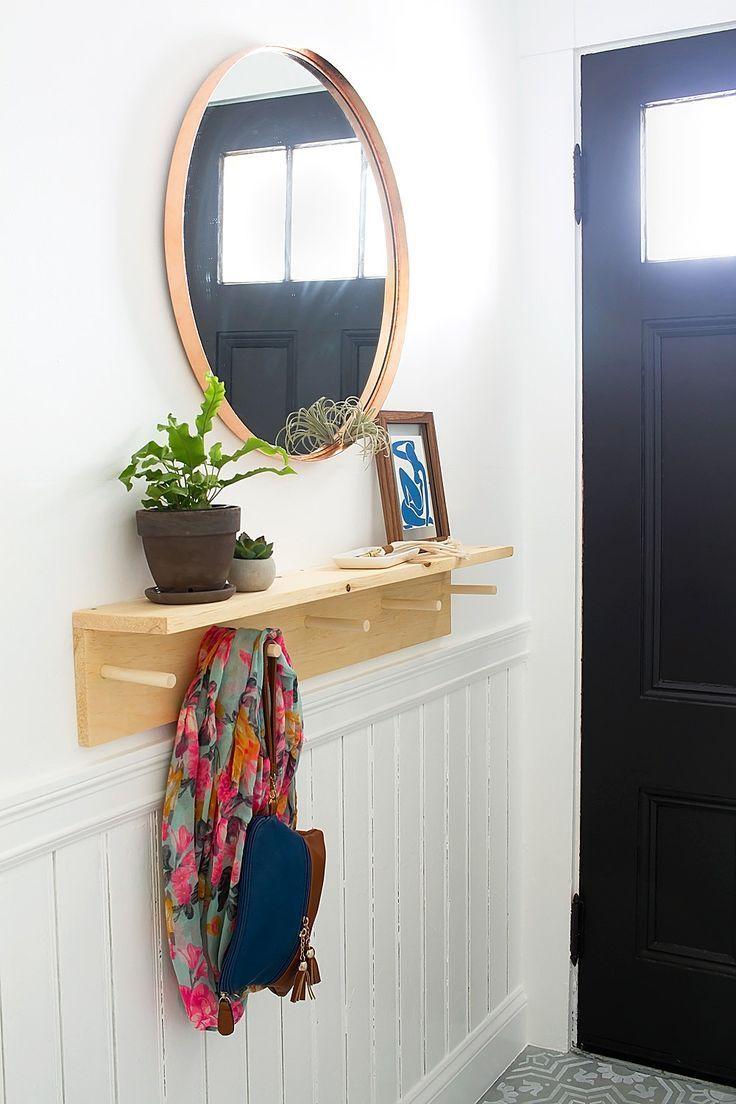 Hallway storage rack  A Bright Organized Entryway  The Reveal  Organized entryway