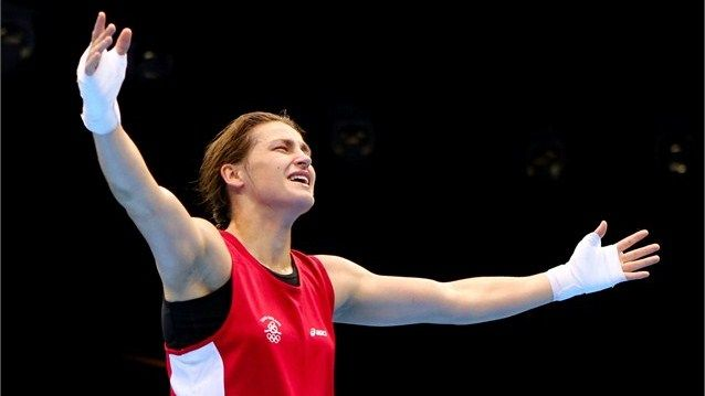 Katie Taylor of Ireland celebrates winning her bout against Sofya Ochigava of Russia during the Women's Fly (51kg) Boxing final bout on Day 13.