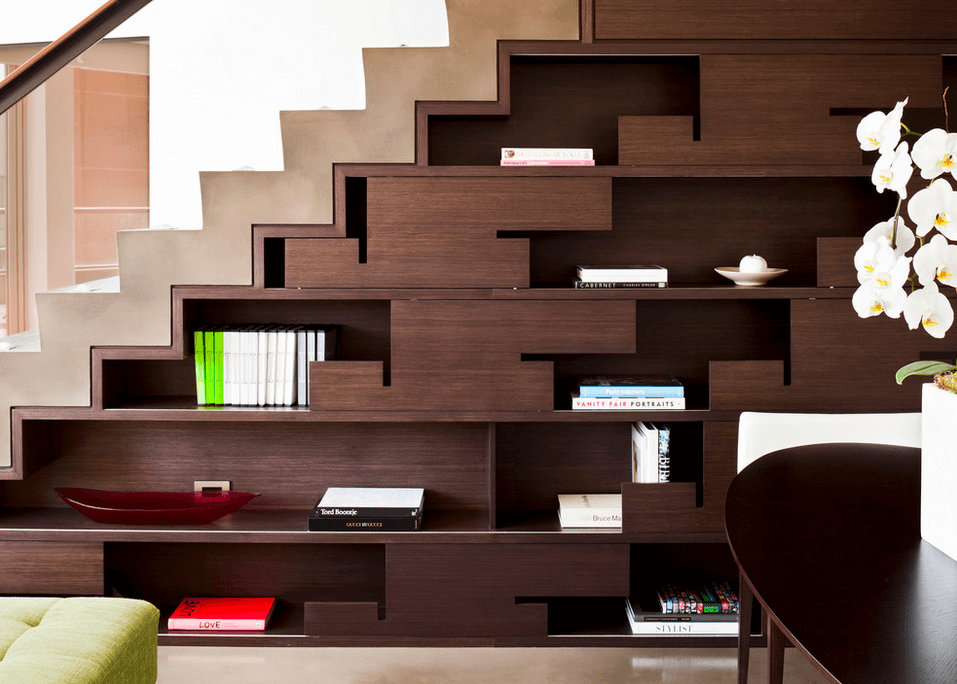 Staircase Shelving modern dark wood shelves - sleek drawers below the stairs make a