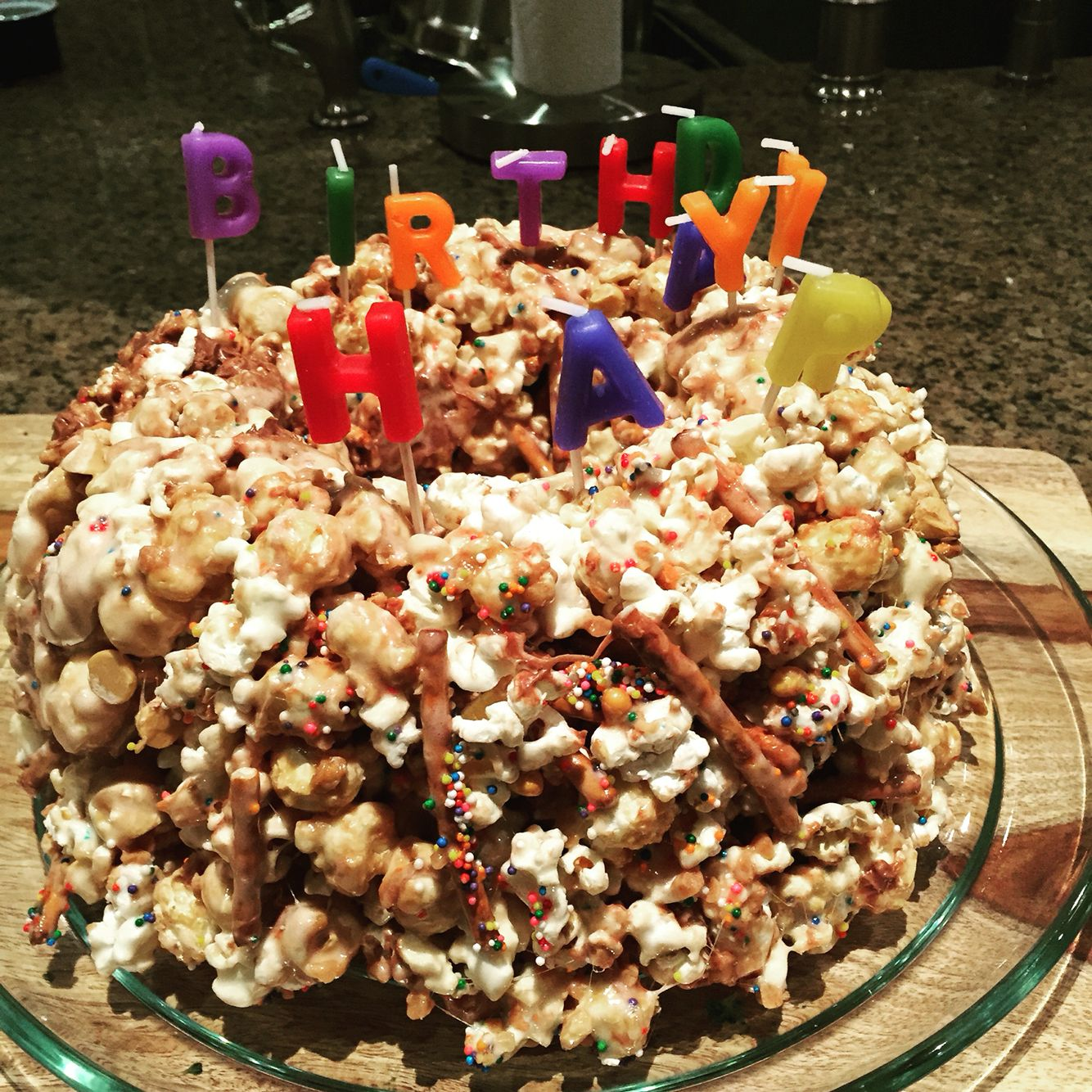 A very cool cake made with popcorn, pretzels, marshmallows, butterscotch chipits and sparkles. I am so proud of Benj