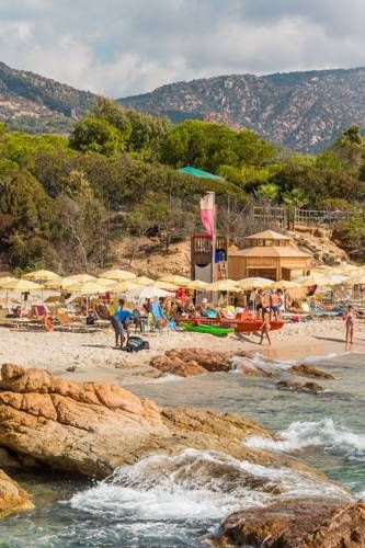 Hotel Rocca Dorada Santa Magherita di Pula Located 700 metres from Pula's beautiful beaches, Hotel Rocca Dorada is surrounded by parkland and pine woods. It offers a private beach area and 2 swimming pools. A spa is also available on site.