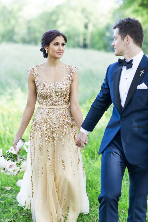 7b7ca27e7d3 a sparkling gold embellished wedding gown will help you stand outin any  outdoor snowy shots