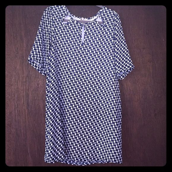Needle & Thread vintage-inspired shift dress L Needle & Thread vintage-inspired shift dress Size large, navy and white geometric print, built in slip. Lightweight flowing comfy, 3 flattering cut-outs at front neckline. Unworn; plastic tab of the tag is still attached but the paper tag was removed. No flaws Needle and Thread Dresses