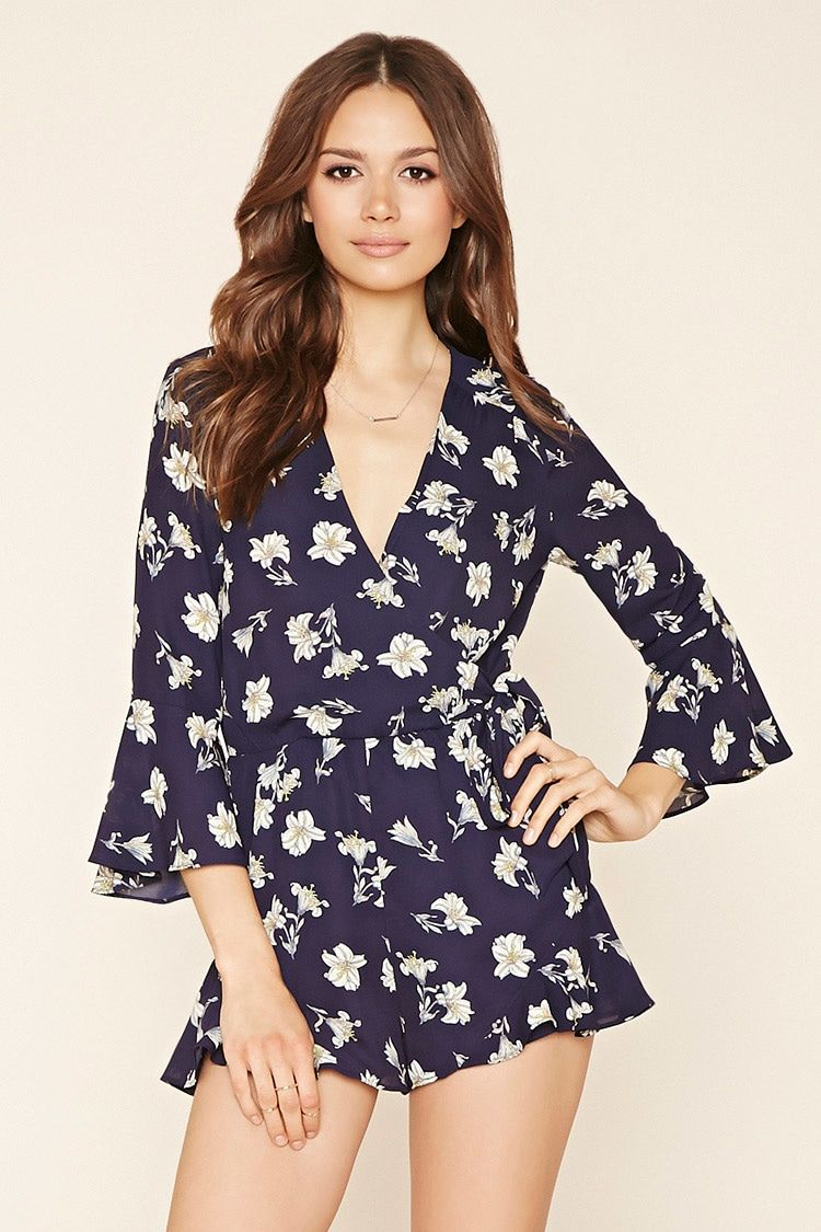 fef965f5a9e Forever 21 Contemporary - A woven romper featuring an allover floral print  with a self-tie surplice front