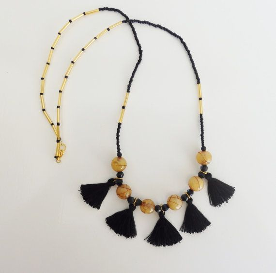 Necklace with small black beads and gold beads by MontradaCarolina