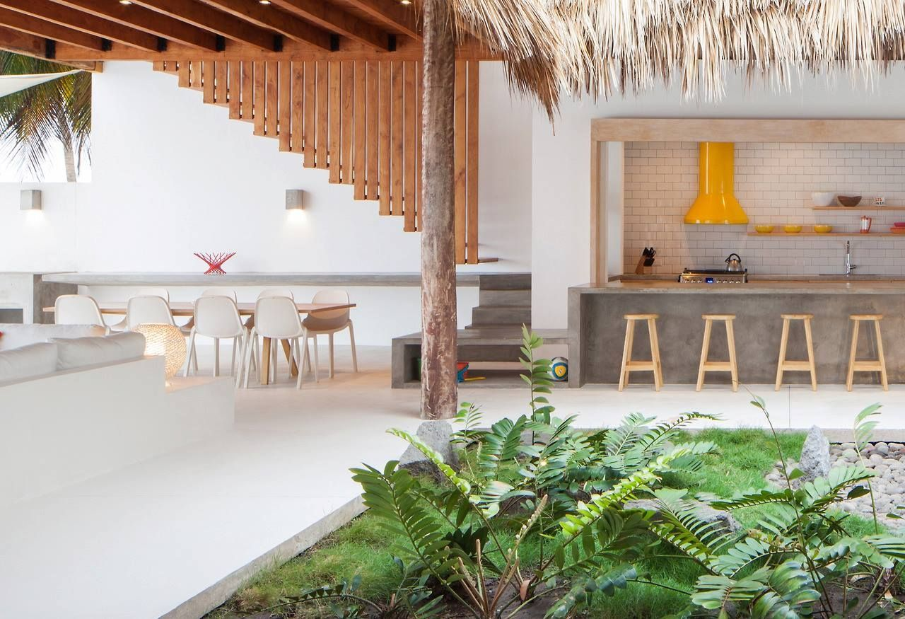 Beach House Costal Azul in El Salvador. by Cincopatasalgato with interiors by Harry & Claudia Washington, Emeco White Broom Chairs (made of reclaimed industrial waste) photos by Jason Bax Photography.