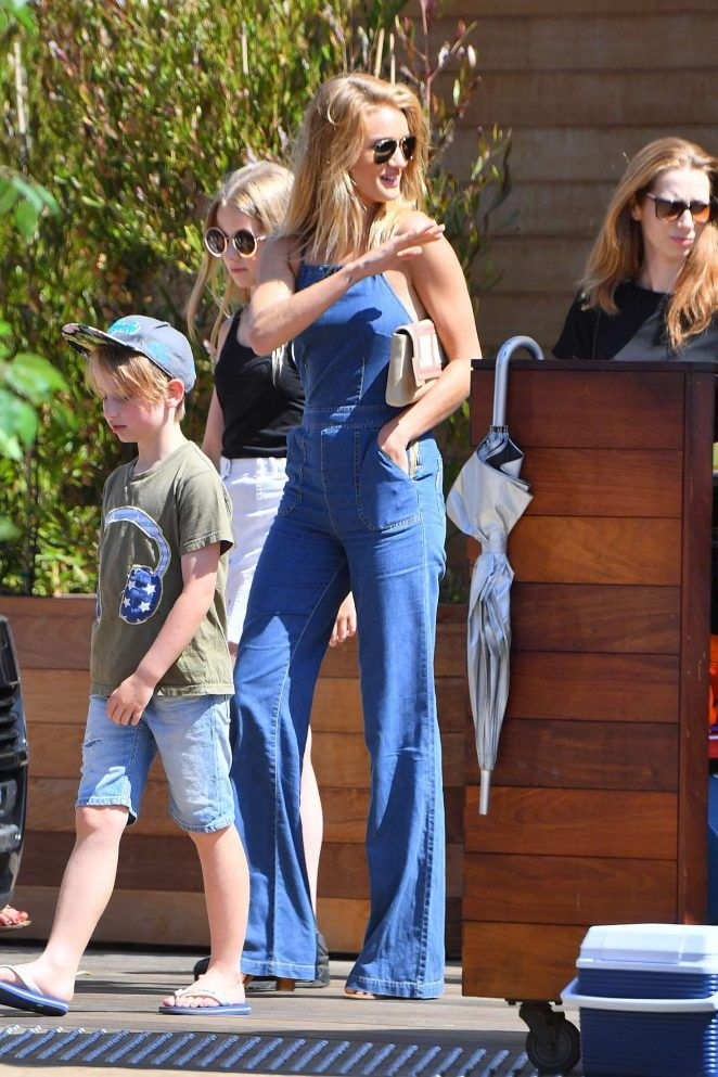 697f73b0182 Rosie Huntington-Whiteley headed into Soho House Malibu in a  241 Paige  Rihannon Denim Jumpsuit and  995 Gianvito Rossi Leather Lace Up Gladiator  Sandals  ...