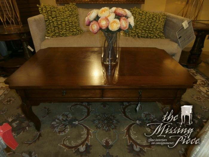 Two Drawer Coffee Table In A Deep Espresso Finish With Curved Legs.  Measures 50*