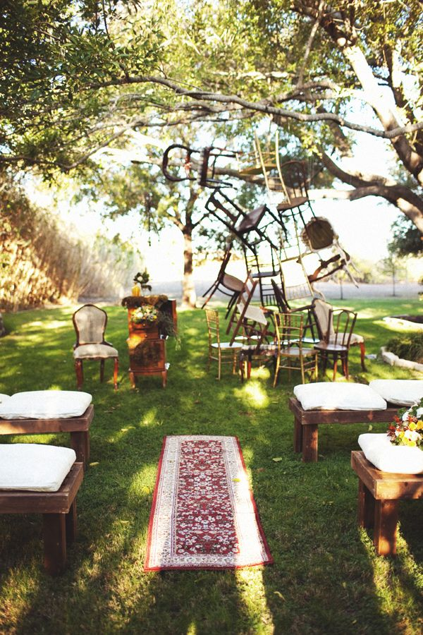 Vintage chair ceremony backdrop - Town and Country Wedding Ideas by ee photography - via ruffled