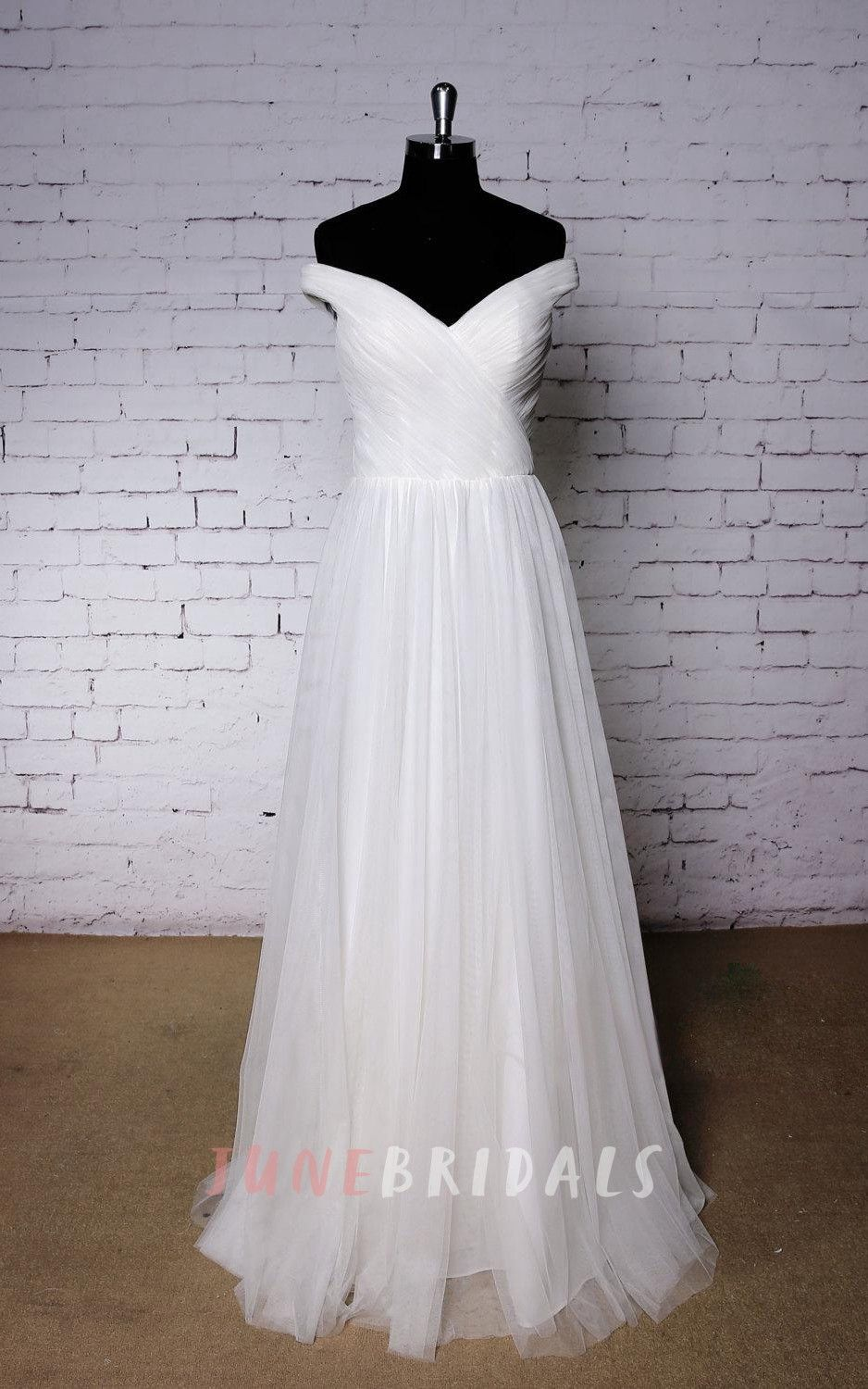 Plain offshoulder tulle wedding dress with ruching and pleats