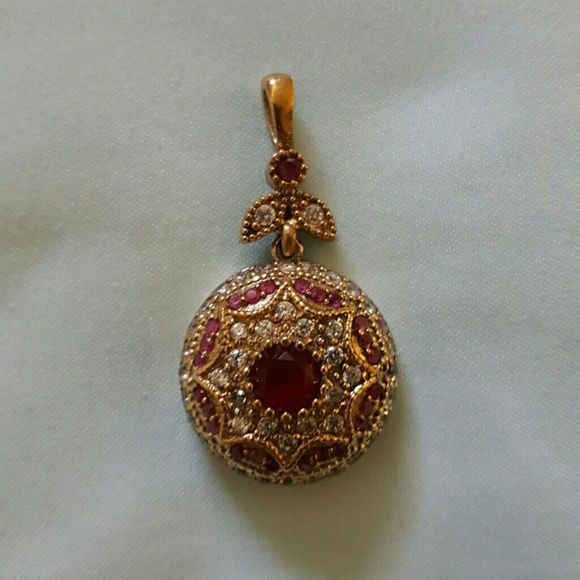 """TURKISH 925 RUBY & WHITE TOPAZ PENDANT STUNNING DETAIL IN THIS HAND CRAFTED TURKISH 925 SILVER AND BRONZE RUBIES WITH WHITE TOPAZ PENDANT.  THESE PIECES OF JEWELRY ARE MADE IN VERY SMALL QUANTITIES, EACH ONE BEING ONE-OF-A-KIND, HEAVY DUTY SOLID JEWELRY TO LAST FOR MANY YEARS TO COME, MAKES A GREAT GIFT FOR ALL. PENDANT MEASURES 1.5-2"""" CHAIN NOT INCLUDED. HANDMADE VINTAGE Jewelry Necklaces"""