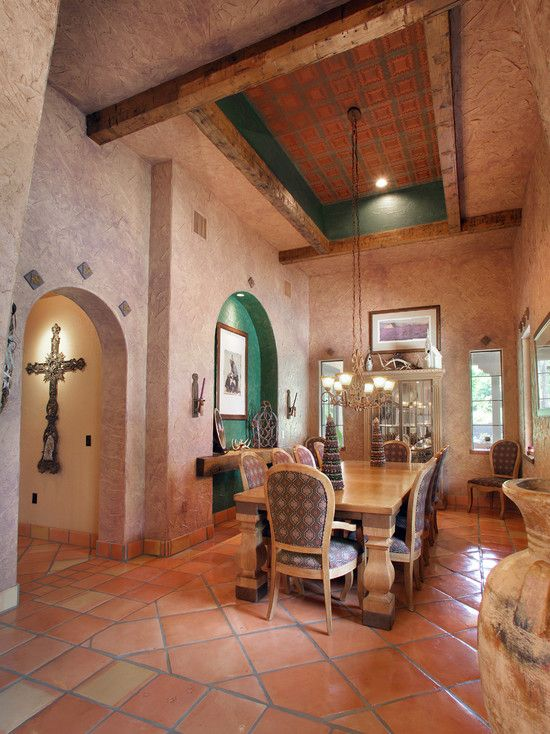Beautiful spanish style dining room with terracotta tile for Spanish style floor tiles