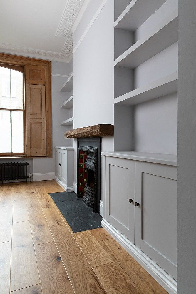 Photo of bespoke_alcove_cabinets_and_chunky_floating_shelves_by_Adam_J_Whittle