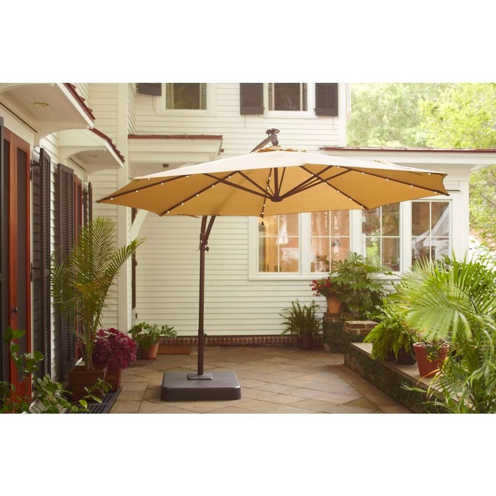 Hampton Bay 11 Ft Offset Led Patio Umbrella In Tan Uxm05201a The Home Depot Patio Offset Patio Umbrella Cantilever Patio Umbrella