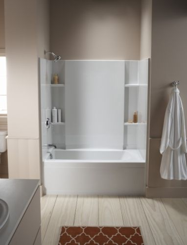 By designing acrylic tub surrounds with different built-ins shelving ...