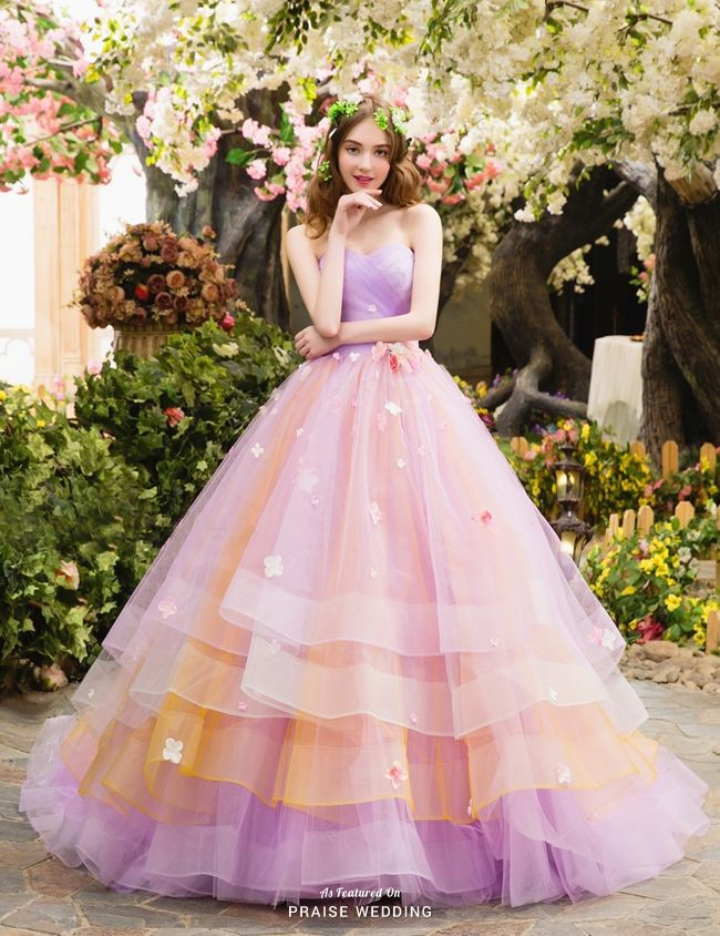 This lovely gown from Marry Me Japan filled with whimsical colors is ...